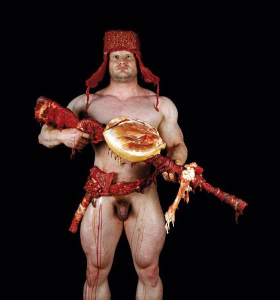 Dimitri Tsykalov - Scatti di uomini che imbracciano armi rivestite di carne