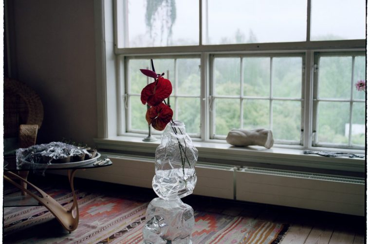 Eros Torso, water bottles transformed into design vases