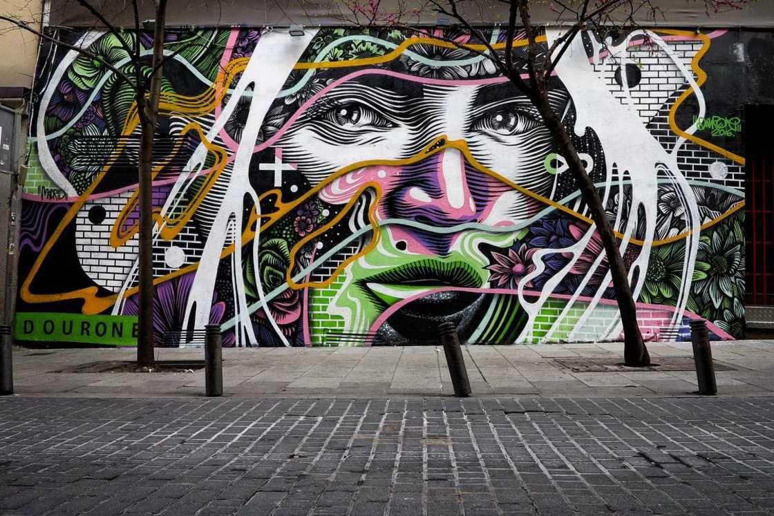Il realismo colorato della street art di Dourone | Collater.al