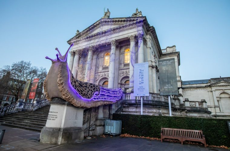 Monster Slug, two giant slugs walking on the facade of the Tate Britain