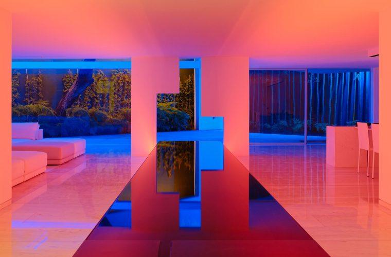 Rombo IV, a minimalist style villa that lights up with neon at night