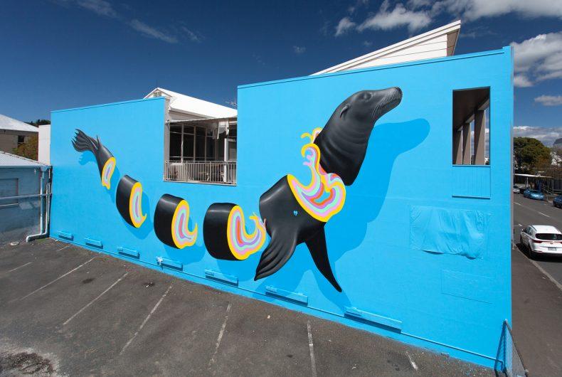 Layered, multicoloured street art by Gina Kiel