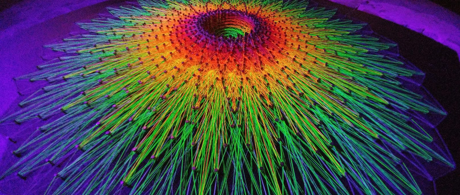 DecodeTheCode, String Art and installations made of wires and ultraviolet light