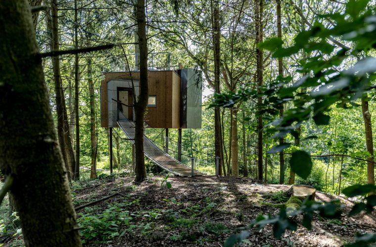 L'Hotel Løvtag formato da cabine perse nella foresta