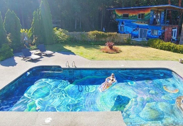 The mural by Ania Amador at the bottom of a swimming pool