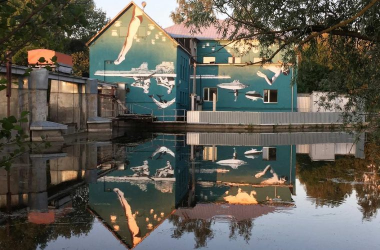 Floating World the mural that reveals itself when reflected in the water