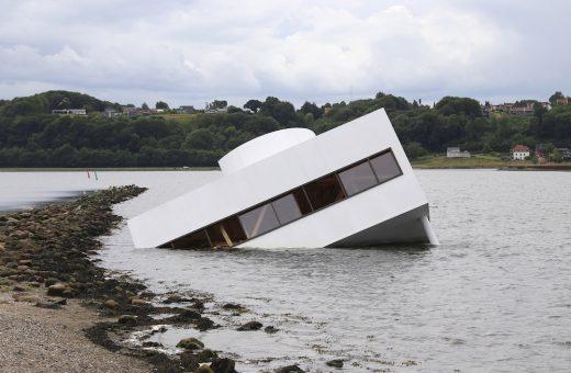 Flooded Modernity, the semi-submerged house