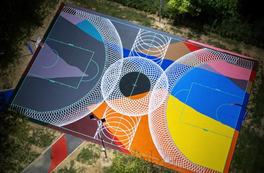 Moneyless' work on a basketball court in Oste